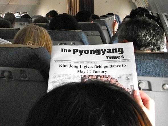 he attendants pass out a propaganda paper before getting off the ground. Guess who's on the front page