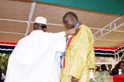 Gambian President Receiving medal
