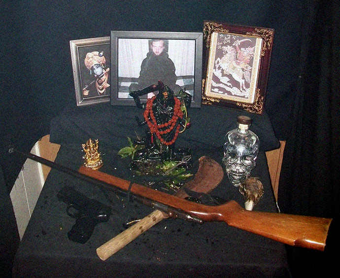 Shrine with automatic weapons of alter of Hindu apocalyptic sect in South Carolina property shared by North Korea U.S. disciples
