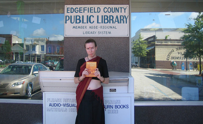 Jillian Hoy, who also claims to be a disciple of the mainstream Hare Krishna Hindu sect, holds up Hare Krishna literature at a rural South Carolina library in 2009