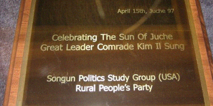 A plaque presented by the Rural People's Party and Songun Politics Study Group to Kim Jong Il onKim Il Sung's birthday
