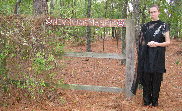 """Jillian Hoy, wife of white power leader, pro North Korea advocate, and Jim Jones supporter Joshua Caleb Sutter. Here Hoy, who bills herself a Hindu priestess Jayalalita Devi Dasi, is pictured at the rural South Carolina property where the Hindu temple New Bihar Mandir is located which worships the deity Kali, the """"Goddess of Destruction"""" is located"""