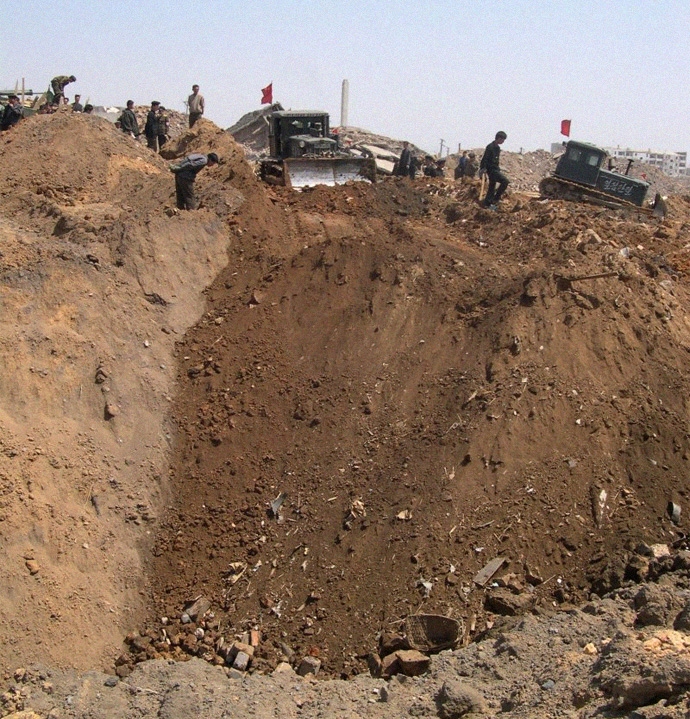 Photo of crater after explosion, Ryongchon 2004   Picture credit: David Hill, ECHO