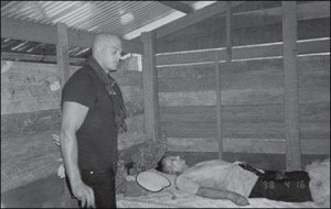 Journalist Nate Thayer views the body of Pol Pot