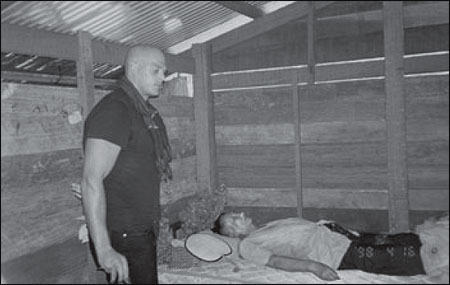 Pol Pot lying down, dead: Nate Thayer standing up, alive. Photo (c) Nate Thayer. No reproduction, transmission or use without express written permission of the author