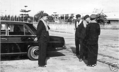 Pol Pot and other top Khmer Rouge leaders stand next to the Mercedes 600 stretch limousine in file pictures from their Killing Fields reign in power