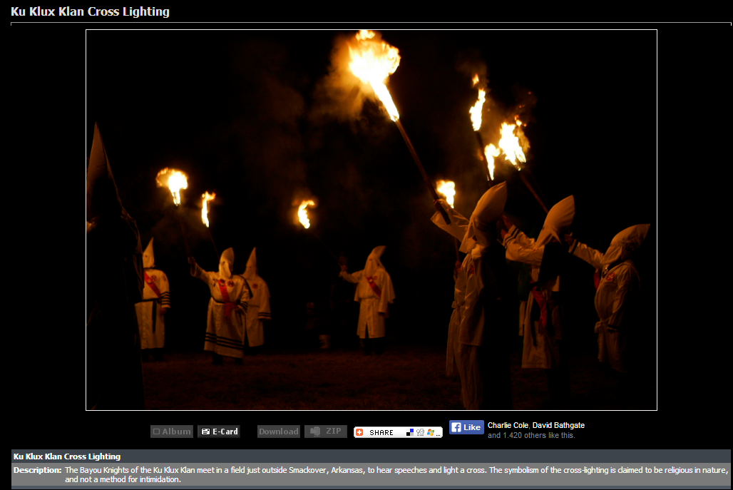 "A photograph posted on June 27, 2013 by the New Empire Knights of the KKK as their ""First Cross Lighting by the New Empire Knights 3-3-2013; Georgia"" is actually this cross burning by the Bayou Knights of the KKK outside Smackover, Arkansas taken on March 3, 2005 in a 2006 photo taken and copyrighted by Mike Fox/Think First Media"
