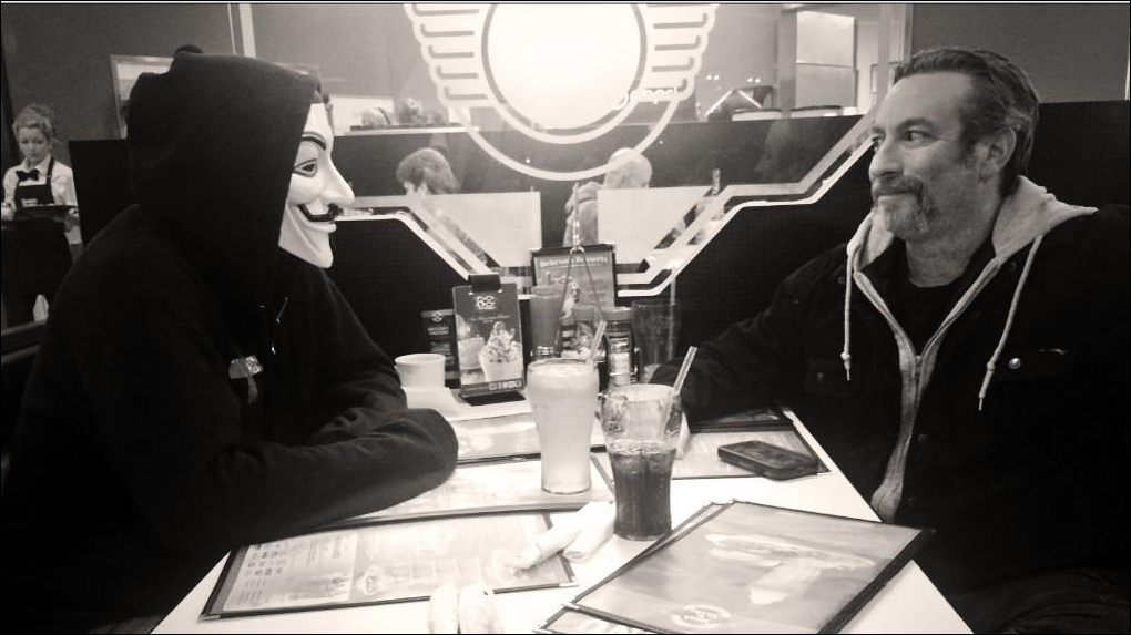 """The Ku Klux Klan Imperial Wizard Frank Ancon meets with a member of Anonymous at a Missouri """"Steak and Shake"""" Sunday afternoon"""