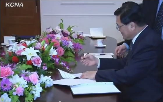President of the North Korean official propaganda arm, the KCNA, signing the agreement made with AP to open a news bureau in Pyongyang on January 16, 2012. Kim Pyong Ho was promoted to deputy director of the Department of Propaganda and  Agitation of the ruling Korean Worker's Party shortly after AP inaugurated their news bureau (Photo KCNA)