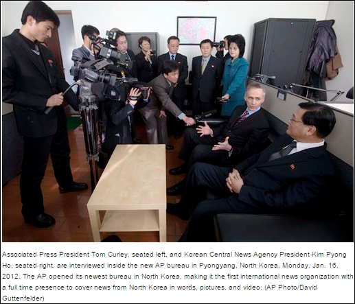 AP and NK officials open AP news bureau in Pyongyang, January, 2012. Rear center is the North Korean official from the Ministry of Foreign Affairs who AP pays directly in hand couriered cash payments of $12,000 a month the salaried of the AP news reporters they were ordered to hire by the regime.