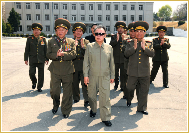 North Korean Reconnaissance General Bureau chief General Kim Yong Chol (l) with then North Korean supreme leader Kim Jong Il on a visit to the the RGB military unit headquarters in 2010