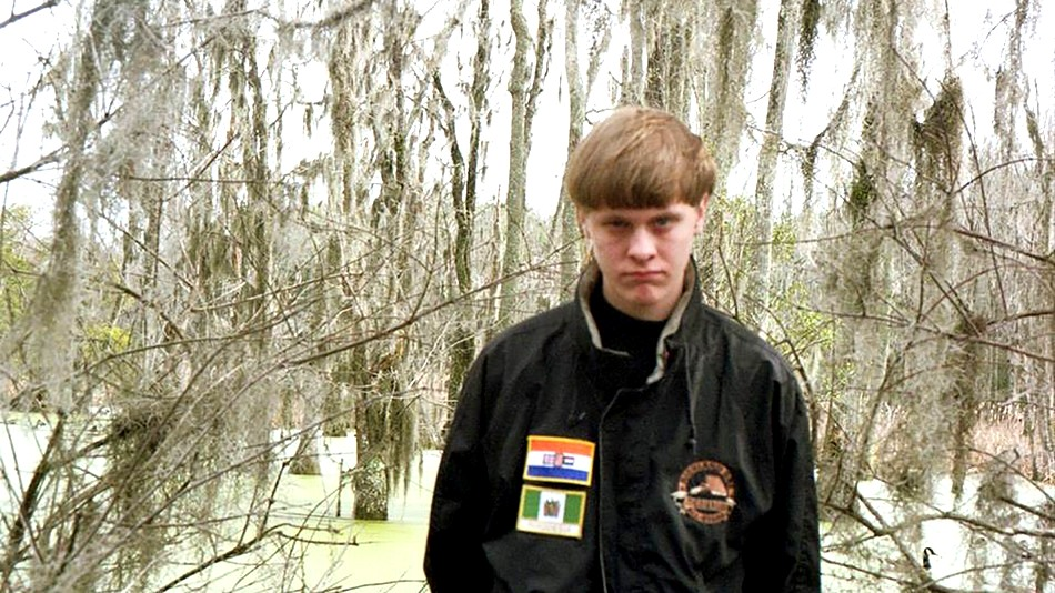 Dylann Roof wearing a jacket with two patches of an Apartheid era South African Flag and flag from the white ruled government of Rhodesia