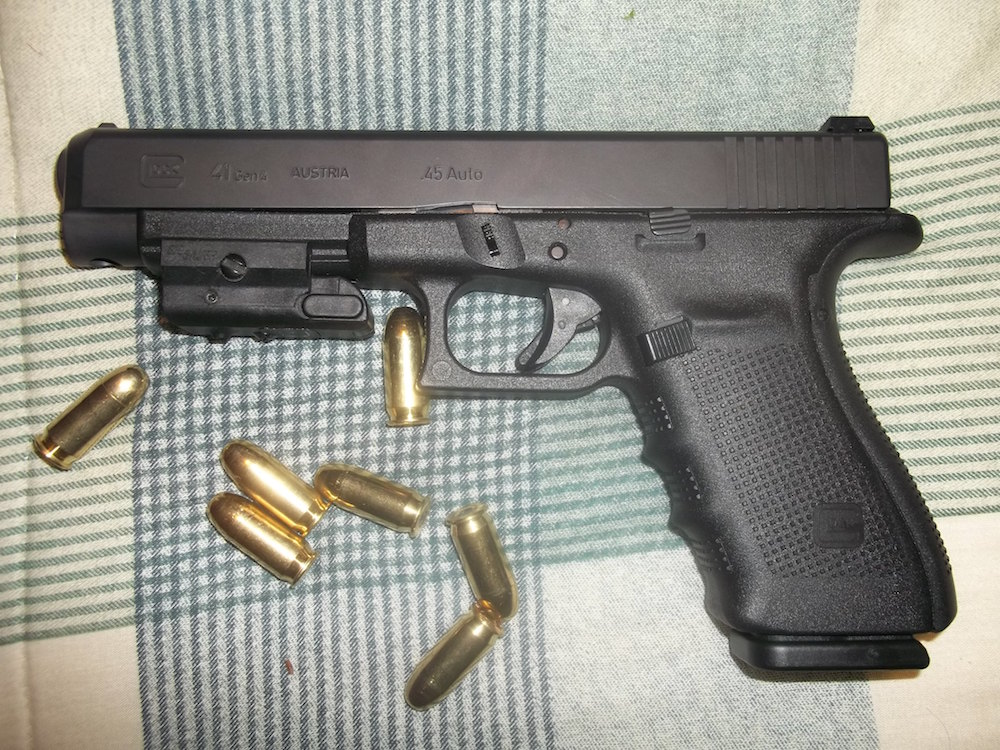 Photo of Dylann Roof's .45 Glock which he was gifted for his birthday and used on June 17 to murder 9 members of a Black church in Charleston, South Carolina