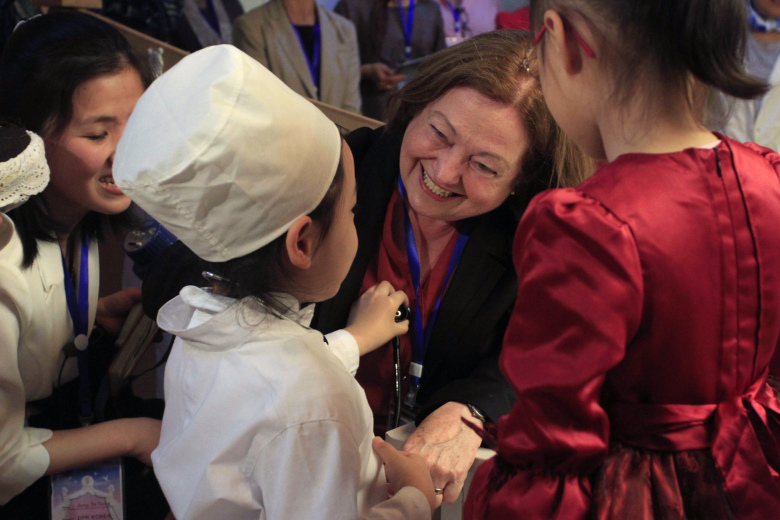 Nobel Peace Prize laureate Mairead Maguire, center, greets children at Kyongsang kindergarten in Pyongyang Wednesday, May 20, 2015. A group of female peace activists including Gloria Steinem and two Nobel laureates arrived in North Korea's capital on Tuesday for a march across the Demilitarized Zone that they hope will bring world attention to calls for a resolution to tensions on the Korean Peninsula. (AP Photo/Kim Kwang Hyon)