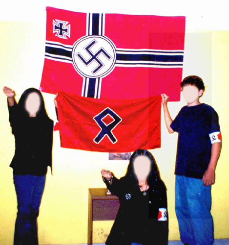 """Peruvian Nazi party flag with """"Sun Wheel"""" symbol depicted on flag in upper left"""