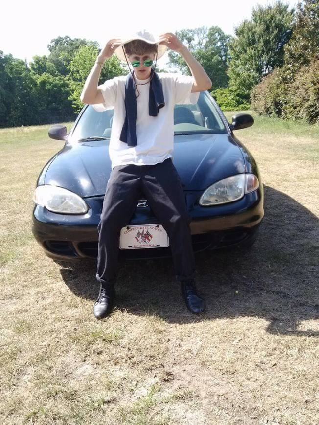 "Dylann Roof, the shooter who murdered 9 people in a South Carolina church this week. Note the car license plate ""Confederate States of America"""
