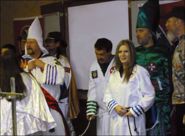Chris Barker and his wife, Amanda, both in the white robes