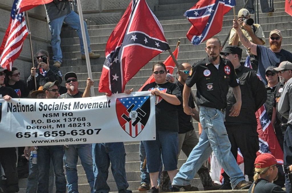 """U.S. Nazi National Socialist Movement with banner who were the overwhelming majority in attendance at the South Carolina """"pro Confederate flag"""" rally July 18"""