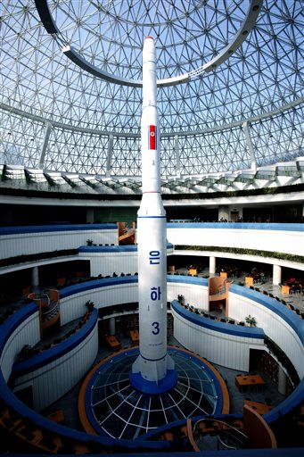 "AP PHOTO FROM FOUR DAYS AGO WHICH AP LABELED A ""FILE PHOTO""- In this Feb. 3, 2016, file photo, a model of the Unha 3 space launch vehicle is displayed at the Sci-Tech Complex in Pyongyang, North Korea. The Unha 3 rocket that launched the ""Bright Star"" satellite into space in 2012 is a symbol of North Korea's technological successes and a matter of great national pride. (AP Photo/Kim Kwang Hyon, File)"
