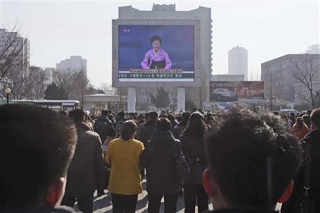 "Photograph released by the AP taken by their ""staff photographer"" of yesterday's nuclear missile delivery system missile launch. The caption, like all those in this article, are from the AP:North Koreans applaud as they watch an electronic screen announcing the launch of a satellite on Sunday, Feb. 7, 2016, at the Pyongyang Railway Station in Pyongyang, North Korea. North Korea on Sunday defied international warnings and launched a long-range rocket that the United Nations and others call a cover for a banned test of technology for a missile that could strike the U.S. mainland. (AP Photo/Kim Kwang Hyon)"