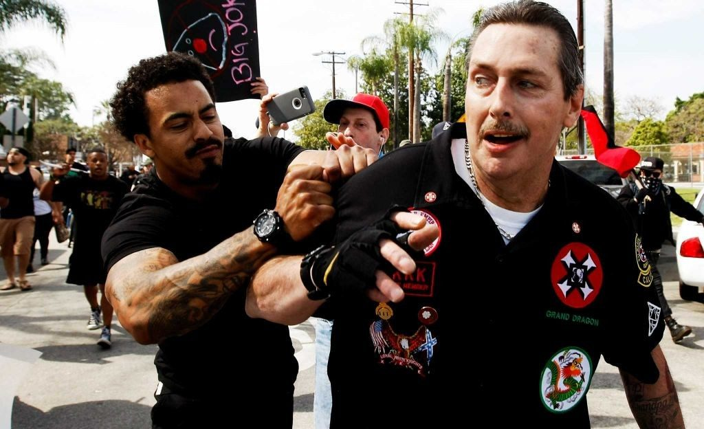 (KKK California state Grand Dragon William Quigg being roughed up by counter protestors (Photo Luis Sinco / Los Angeles Times via the AP)