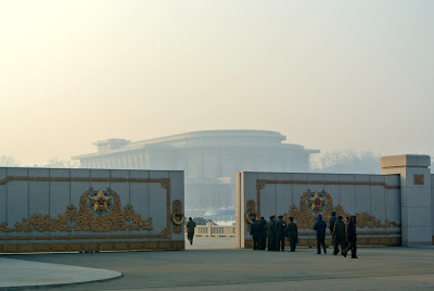 "On the requisite tour to pay homage to the Great Leader at the palace, she writes:""Large, gilded gates outside the Palace. Heavily guarded, military types everywhere. This country has the 4th largest standing army in the world  (1.4 million)  and it's the size of Pennsylvania."
