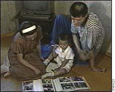 Ri with his wife and child in Pyongyang in 1998. After being refused entry to the U.S. after 8 months in Canada, Kim Jong-il awarded him a gold watch
