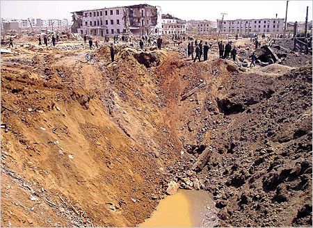 A 72 meter crater at explosion site in North Korea that registered 3.6 on the Richter scale in April 2004. Remnants of a mobile phone wrapped in duct tape were found nearby by investigators