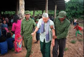 Pol Potbeing led away from his jungle trial. June 25, 1997. Photograph (c) nate Thayer