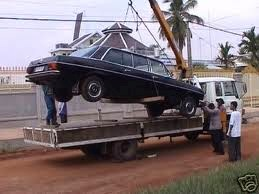 "Pol Pot's Mercedes limousine being hoisted by the film production crew of Matt Damon's Hollywood cult classic ""City of Ghosts"" in Phnom Penh in 2001. The Mercedes limo was featured prominently in the Hollywood film released in 2002"