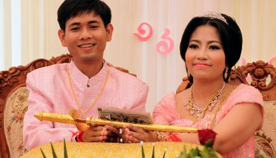 Pol Pot's daughter poses with her groom Sunday March 16, 2014 during a lavish wedding ceremony in western Cambodia. Photo Phnom Penh Post