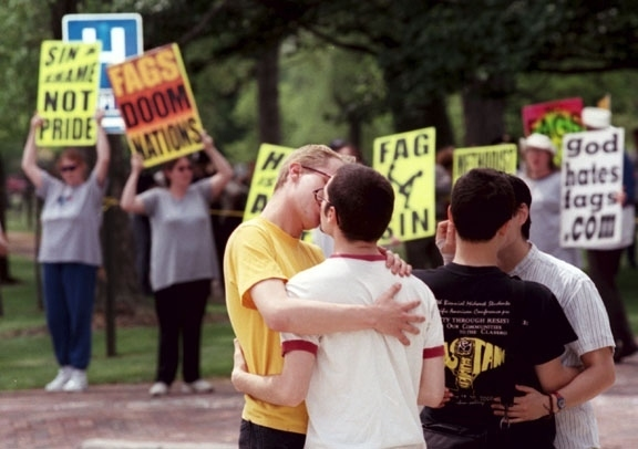 Counter protesters at Westboro Baptist Church demonstration at funeral of victims of gay violence