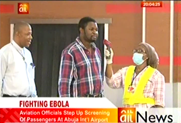 """An airport official at Nigeria's main airport using fraudulent """"Ebola Detector"""""""