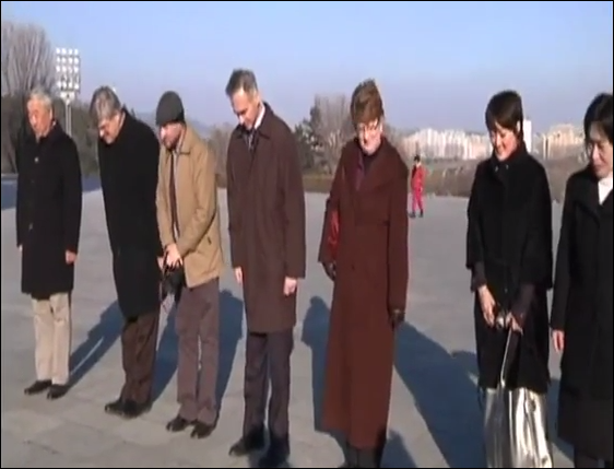 Associated Press top executives bow in front of statue of Kim Il Sung in Pyongyang North Korea in March 2011. From left AP consultant Tony Namkung, AP senior VP for international news, AP photo bureau chief David Gettenfeller, AP president and CEO Thomas Curley, AP senior VP and Executive Editor Kathleen Carroll, AP Pyongyang bureau chief Jean H. Lee, North Korean translator