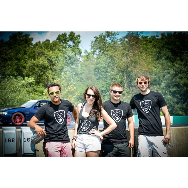"""Photo of Jordan Wallace's """"Broke Racer Club"""". From left to right: Jordan Wallace, Ashley Barrett, and two other friends of Wallace and racing enthusiasts from Annapolis, Maryland"""