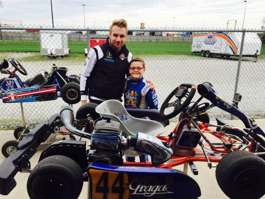 10 year old Philip Savopoulos in his racing go kart earlier this year with his coach, professional Indy Race driver Jay Howard
