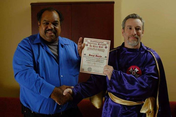 "Daryl Davis (L) being presented with a ""Certificate of Friendship"" by KKK Imperial Wizard Frank Ancona (R) in May 2015"