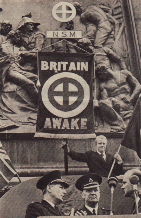 A 1962 photo of a far right wing British neo Nazi political party in Trafalgar Square. Note the symbol on flag which is the same as that drawn by Roof on South Carolina beach in March 2015