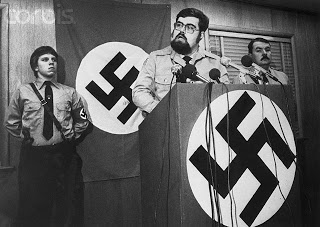 19 Nov 1980, Raleigh, North Carolina, USA --- Nazi leader Harold Covington holds a news conference 11/18 praising the acquittal of six Klansmen and Nazis charged with the slaying of five Communists. He called for North and South Carolina to secede from the Union and form a nation for whites only. Klan leader Gorrell Pierce (R) joined Covington at the conference. --- Image by © Bettmann/CORBIS
