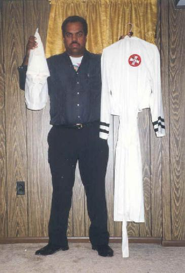 Davis with a Klan robe given to him by a former Imperial Wizard who left the Klan