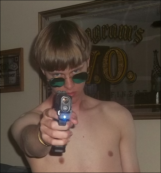 Dylann Roof in a photo he posted on his website lastrhodesian.com shortly before he went on a murder spree killing 9 God fearing people in a bible class in a Black church in South Carolina