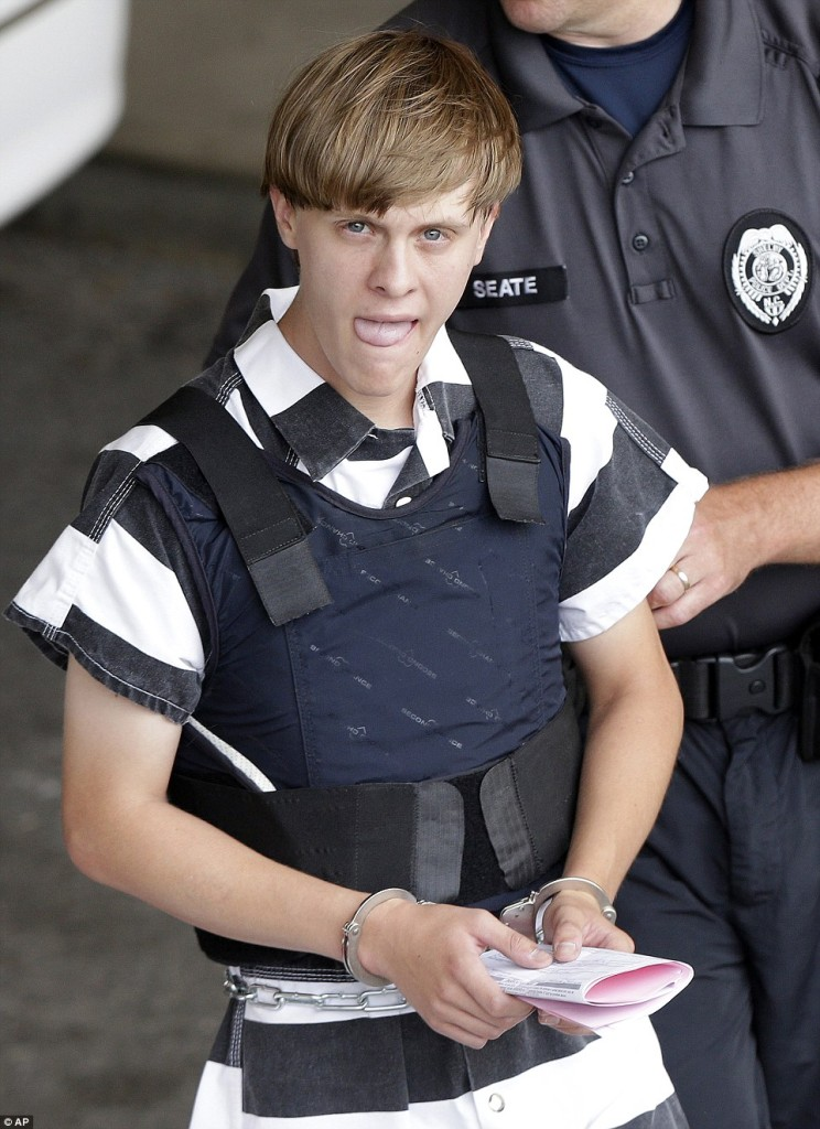 Dylan Roof under arrest June 19, 2015. Note his right hand shows no tattoo