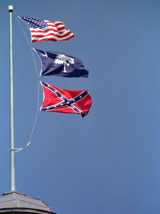 Flags flying over the South Carolina capital in 2000, when the Confederate flag was removed. In center is the South Carolina state flag. Bottom is one version of the Confederate flag