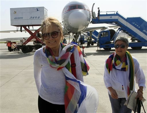 FILE - In this May 19, 2015 file photo, activists Gloria Steinem, left, and Aiyoung Choi arrive at Pyongyang Airport in Pyongyang, North Korea. Steinem and a group of 29 other women from 15 countries are set to walk across the Demilitarized Zone dividing North and South Korea on Sunday, May 24 after obtaining a rare green light from both governments. (AP Photo/Jon Chol Jin, File )