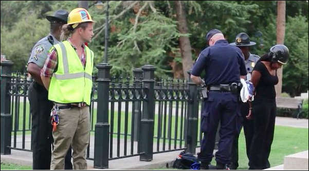 James Ian Tyson under arrest in front of the South Carolina state capitol building for removing the Confederate flag June 27, 2015
