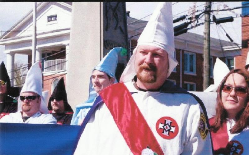 Loyal White Knights Imperial Wizard Chris Barker at a recent Ku Klux Klan rally. On the right his his wife, Amanda Barker