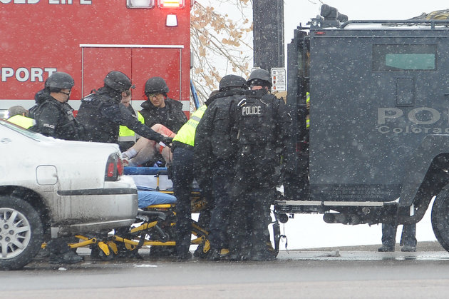 An unidentified victim is transported from the Colorado Springs tactical vehicle to an ambulance after a gunman opened fire at a Planned Parenthood facility on Centennial Boulevard in Colorado Springs, Colo., on Friday, Nov. 27, 2015. The gunman was captured alive. (Daniel Owen/Colorado Springs Gazette/TNS via Getty Images)