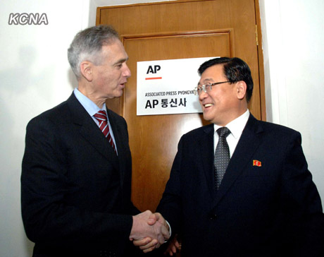Associated Press President Tom Curley, left, and Korean Central News Agency President Kim Pyong-ho stand in front of the AP's new Pyongyang office in January 2012