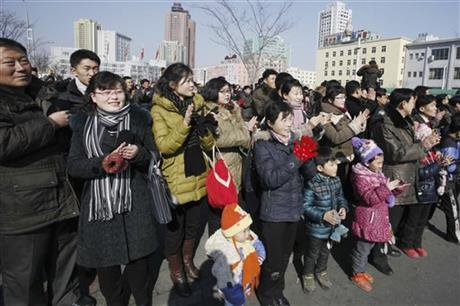 North Koreans applaud as they watch an electronic screen announcing the launch of a satellite on Sunday, Feb. 7, 2016, at the Pyongyang Railway Station in Pyongyang, North Korea. North Korea on Sunday defied international warnings and launched a long-range rocket that the United Nations and others call a cover for a banned test of technology for a missile that could strike the U.S. mainland. (AP Photo/Kim Kwang Hyon)