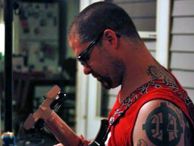 """Wade Michael Page and his Celtic Cross tattoo with the neo Nazi symbol """"14"""" on his left arm. Page murdered six Sikh parishioners at a temple in Wisconsin in August 2012"""